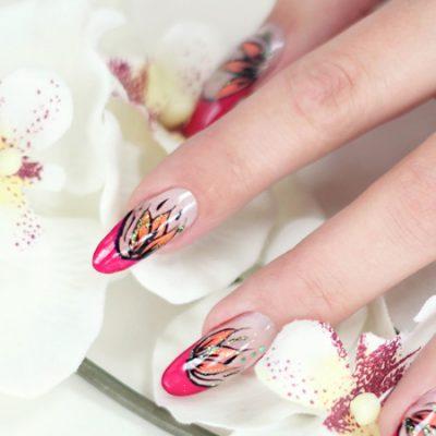 Pinke Spitze mit orangen Blütenblättern